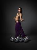 Dancer with disco ball Stock Photos