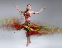 Dancer with disintegrating dress. Abstract vision.Photo manipulation royalty free stock image