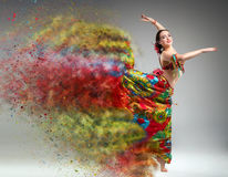 Dancer with disintegrating dress. Royalty Free Stock Photography