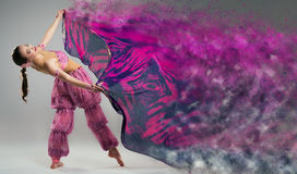 Dancer with disintegrating scarf. Royalty Free Stock Image