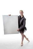 Dancer with display sign. Model in a suit jacket and tutu, holding a blank board ready to display a sign Royalty Free Stock Photo