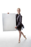 Dancer with display sign. Model in a suit jacket and tutu, holding a blank board ready to display a sign Stock Photography