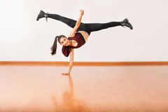 Dancer doing a handstand with leg split Royalty Free Stock Image