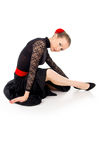 Dancer in dress sitting Stock Images