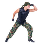 Dancer dressed soldier jumping Royalty Free Stock Image