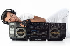 Dancer with earphones and ghetto boom box listening music Stock Image