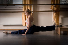 Dancer exercise. Dancer girl is doing exercise on the floor Royalty Free Stock Image