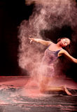 Dancer expressing pink powder royalty free stock photo