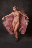 Dancer with feather fans behind her Royalty Free Stock Images