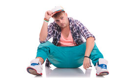 Dancer on the floor holding his hat Stock Images