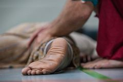 Dancer foot closeup. On a dance floor on a blurred bg royalty free stock image