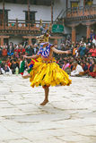 Dancer at the Gangtey Monastery, Gangteng, Bhutan. Dancer with traditional clothes is performing the Mask dance during the Black-necked crane Festival at the royalty free stock photo