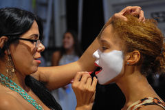 A dancer getting ready with makeup backstage at the Luli Fama fashion show during MBFW Swim 2015 Stock Photos