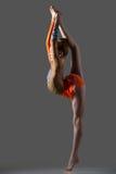 Dancer girl doing standing splits Stock Photos