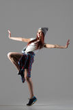 Dancer girl performance. Portrait of one attractive happy fit cute hipster young woman wearing casual clothing and beanie dancing. Modern style beautiful dancer royalty free stock photography