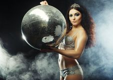 Dancer girl in smoke with disco ball Royalty Free Stock Photography