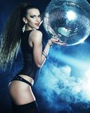 Dancer girl in smoke with disco ball Stock Photo