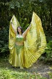 Dancer with golden Isis wings Stock Photography