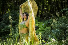 Dancer with golden Isis wings Royalty Free Stock Images