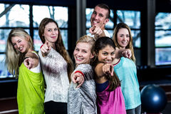 Dancer group pointing the camera. In the gym royalty free stock image