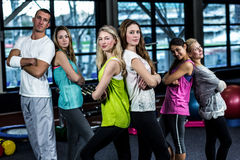 Dancer group posing back to back. In the gym Royalty Free Stock Photos