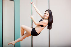 Dancer hanging from a pole Stock Photo