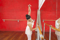 Dancer Holding Barre While Practicing In Ballet Studio Stock Photos