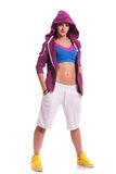 Dancer with hoodie and hands in pockets. Full length picture of a young sporty woman standing with her hands in her pockets and looking confident at the camera Royalty Free Stock Photo