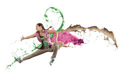 Dancer in jump. Young female dancer in jump on white background with colorful paint plashes Stock Photo