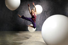 Dancer in the jump. Young dancer is jumping on stage Stock Photography