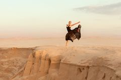 Dancer jumped up during the dance. Stock Photo