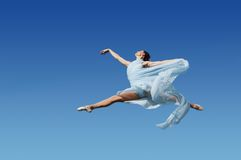Dancer jumping against blue sk Royalty Free Stock Photo