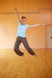 Dancer jumping into the air. Happy female dancer jumping into the air royalty free stock photos