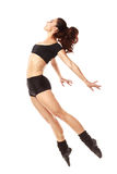 Dancer jumping behind studio background Royalty Free Stock Photography