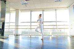Dancer jumping  with close up air kiss. Guy jumping  and sending close up air kiss. Male person wears white suit. Concept of dance school and promotion Stock Image