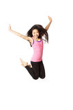 Dancer Jumping. Full body portrait of asian american dancer jumping in studio on white background wearing casual athletic clothing (pink stock photography