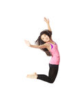 Dancer Jumping. Full body portrait of asian american dancer jumping in studio on white background wearing casual athletic clothing (pink Royalty Free Stock Photo