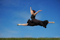 Dancer jumping on grass Stock Image