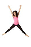 Dancer Jumping and Laughing. Full body portrait of asian american dancer jumping in studio on white background wearing casual athletic clothing (pink stock images