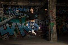 Dancer jumping and making eye contact Royalty Free Stock Photos