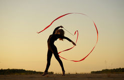 Dancer jumping with ribbon Royalty Free Stock Images