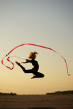 Dancer jumping with ribbon Royalty Free Stock Photos
