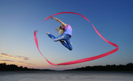 Dancer jumping with ribbon Stock Images