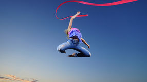 Dancer jumping with ribbon Stock Photos