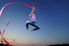 Dancer jumping with ribbon Royalty Free Stock Photography