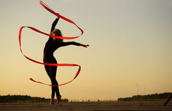 Dancer jumping with ribbon Stock Image