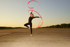 Dancer jumping with ribbon Stock Photo