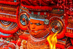 Dancer in Kerala. Thottada, south of Kannur, Kerala - circa January 2012: Mask of dancer during Theyyam near Thottada, south of Kannur, Kerala. Documentary Stock Photography