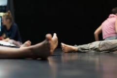 Dancer leg, foot. Many dancer leg, foot on a dark dance floor blurred royalty free stock photo