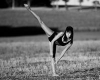 Dancer looking for balance in a field stubble. Stock Photography